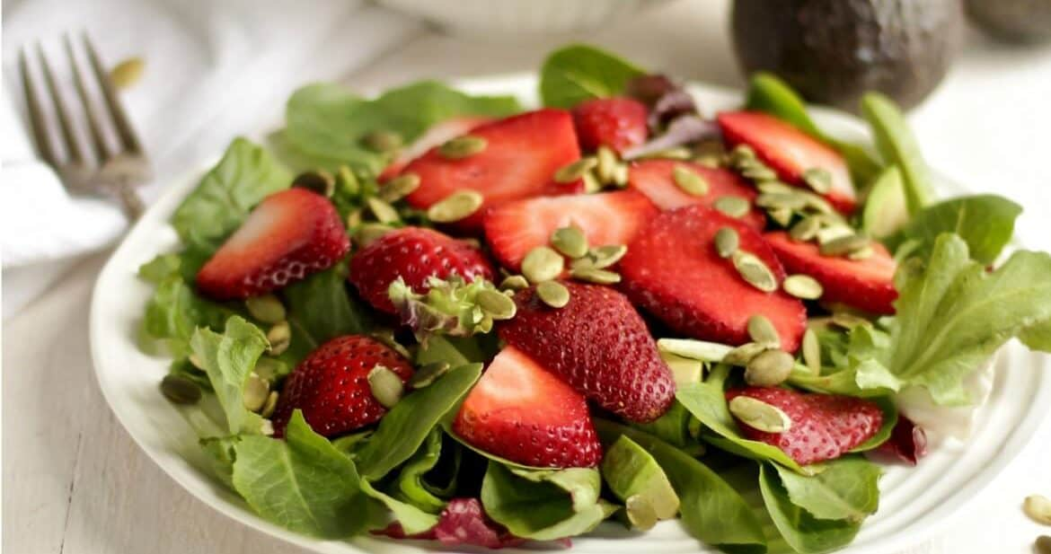 Fresh green salad with strawberries