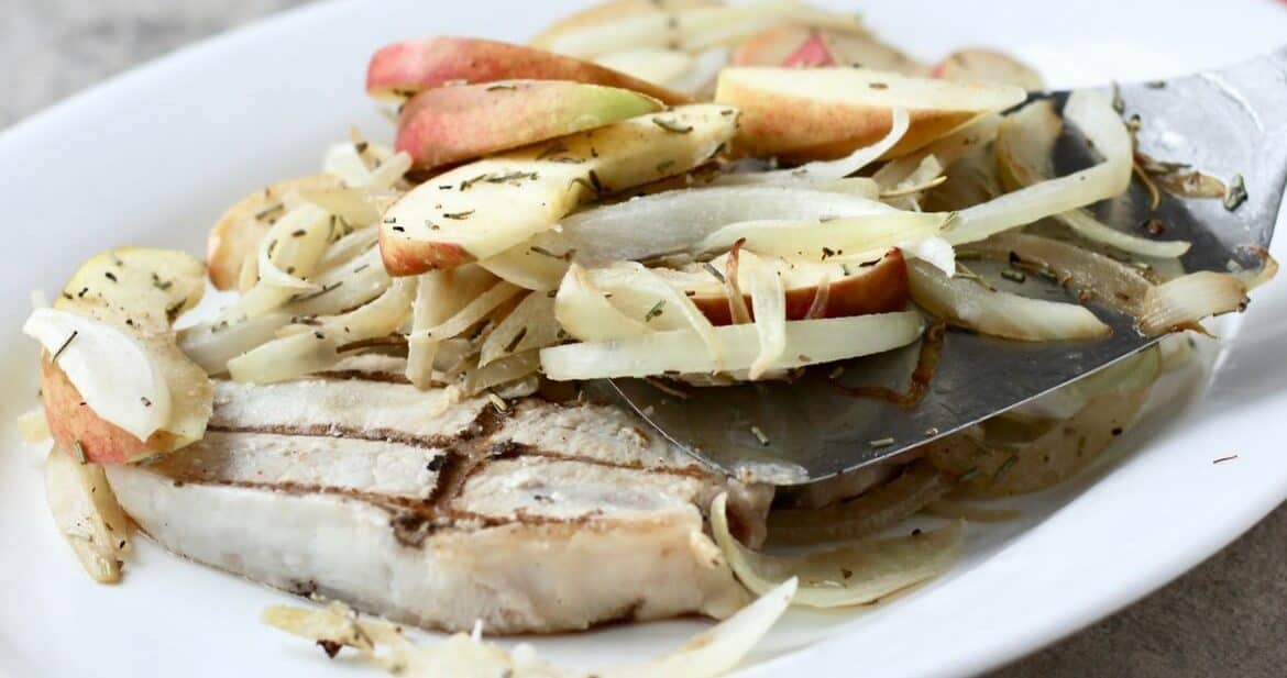 Grilled Pork Chops Topped with Apples and Onions