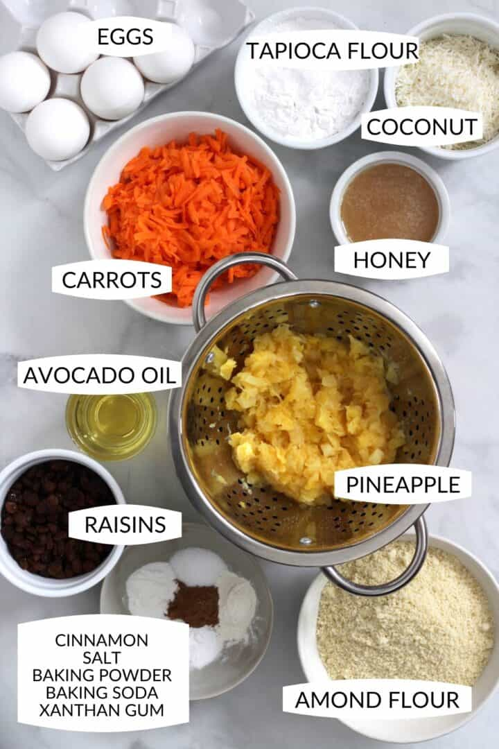 ingredients for carrot cake in individual bowls with labels