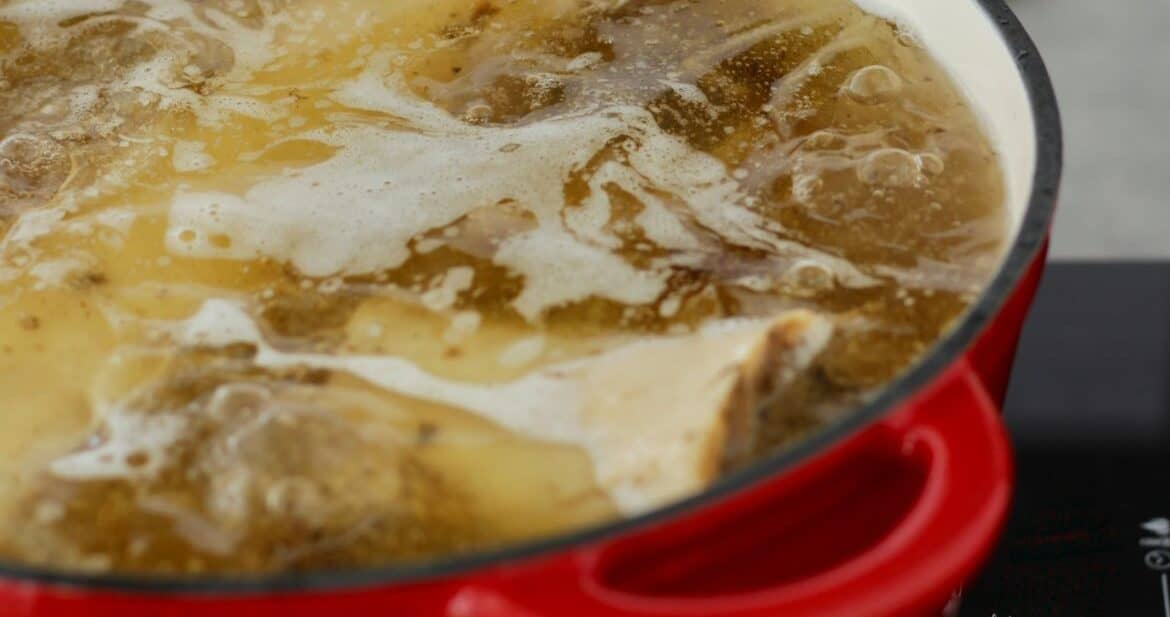 closeup of bone broth in pot