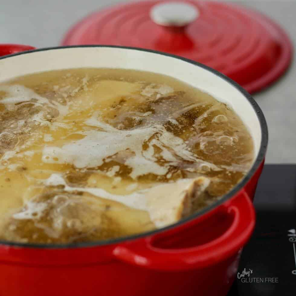 Healing Bone Broth or Stock Simmering in the Pot