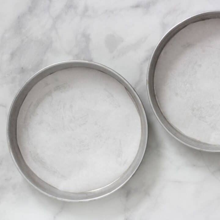 two round cake pans lined with parchment paper