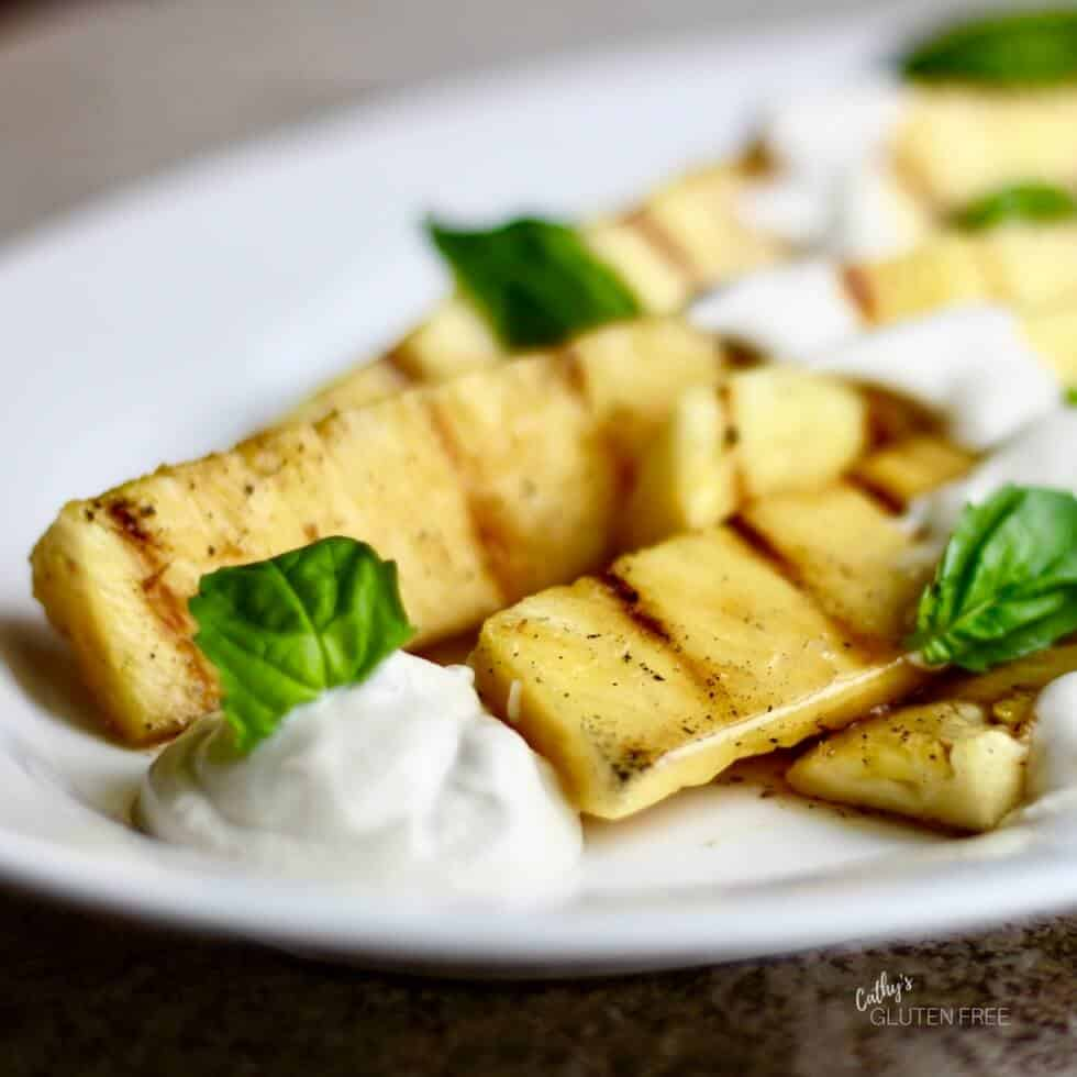 Grilled Pineapple Spears with Cardamom Maple Syrup and Vegan Yogurt