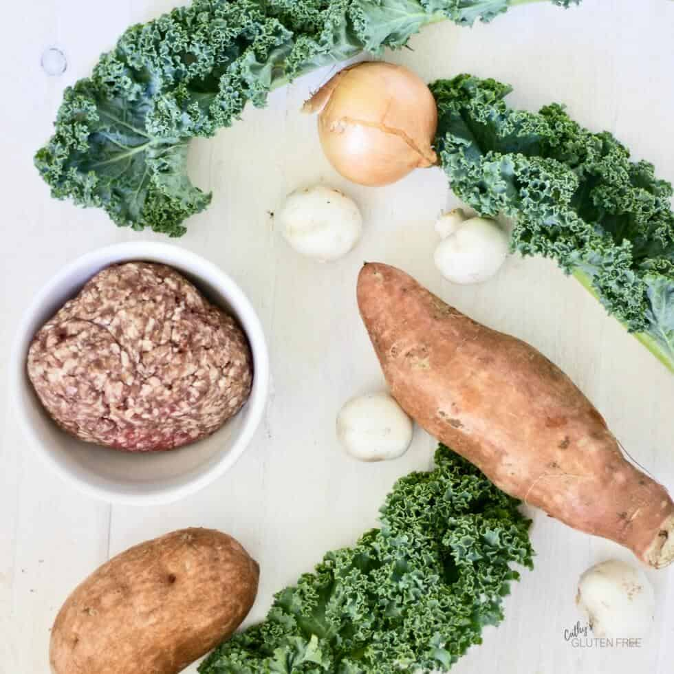 Kale, sweet potato, onion, and mushrooms dress up ground beef nicely.
