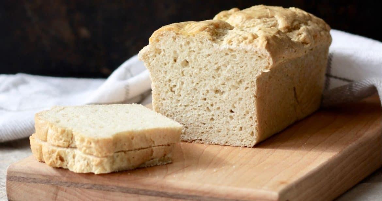 sliced gluten free sorghum bread on wooden board