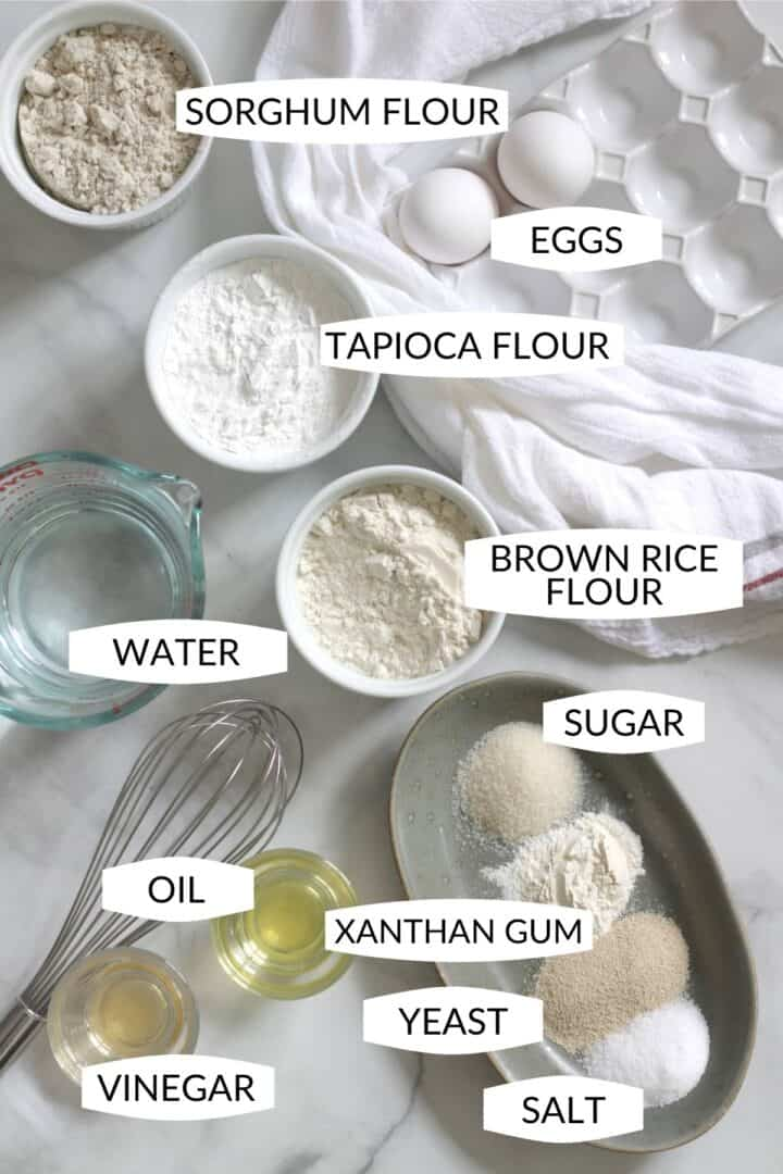 ingredients for making gluten free sorghum bread in small bowls with labels