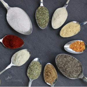 spoons of spices arranged in a circle
