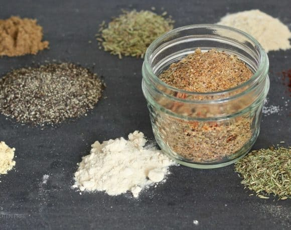 Spice mix in a jar with piles of spices around it