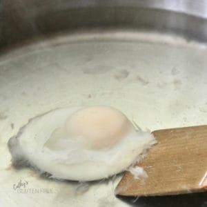 Move the egg around and gently flip it over to cook it evenly.