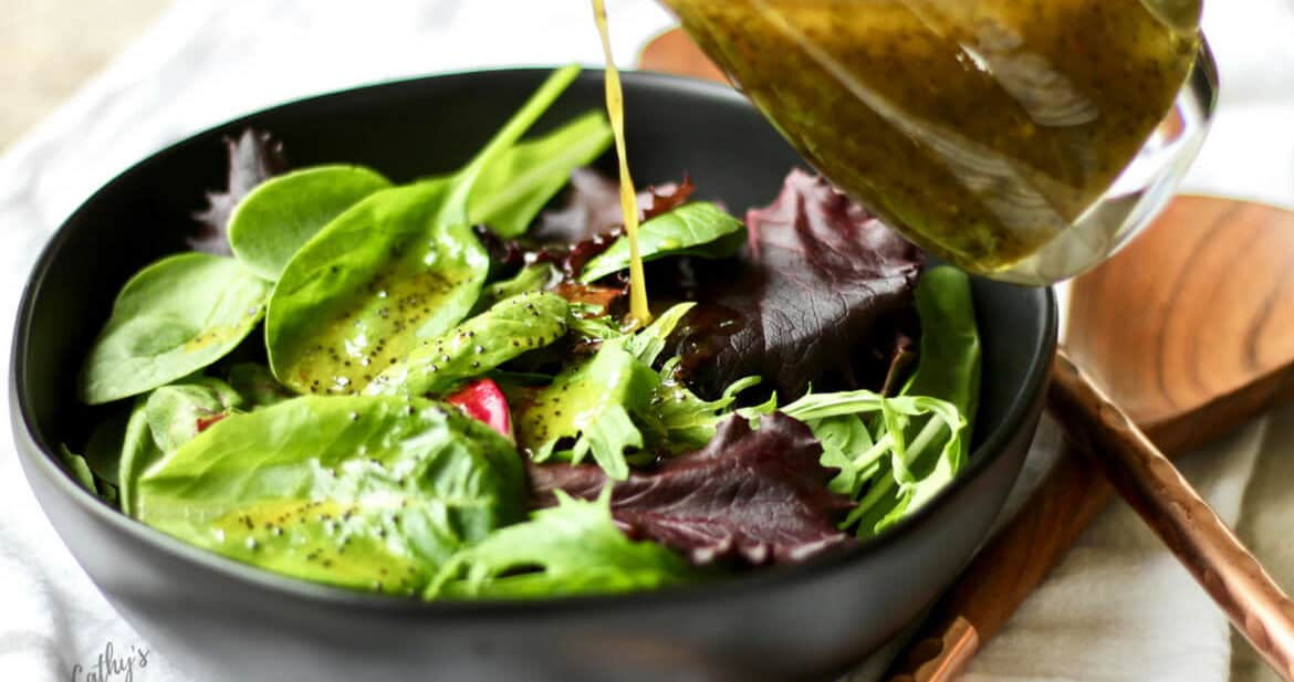 poppy seed salad dressing pours beautifully over a fresh green salad