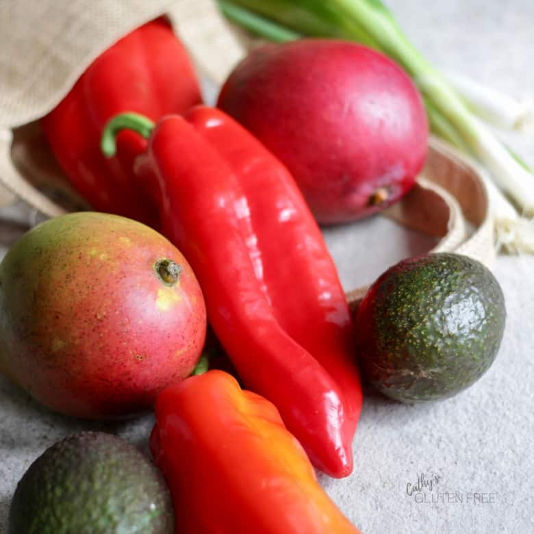 Red pepper, mangos, green onions, and avocado