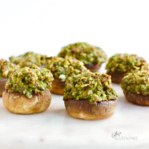 golden, greenish, chopped filling piled into mushroom caps