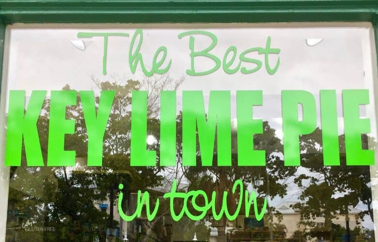 """The Best Key Lime Pie in Town"" sign on glass window"