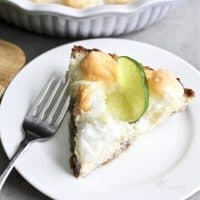 slice of key lime pie garnished with a slice of lime