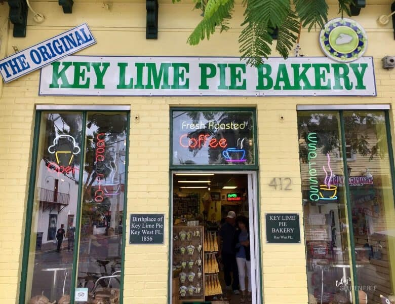 """Original Key Lime Pie Bakery"" green lettered sign on yellow wall"
