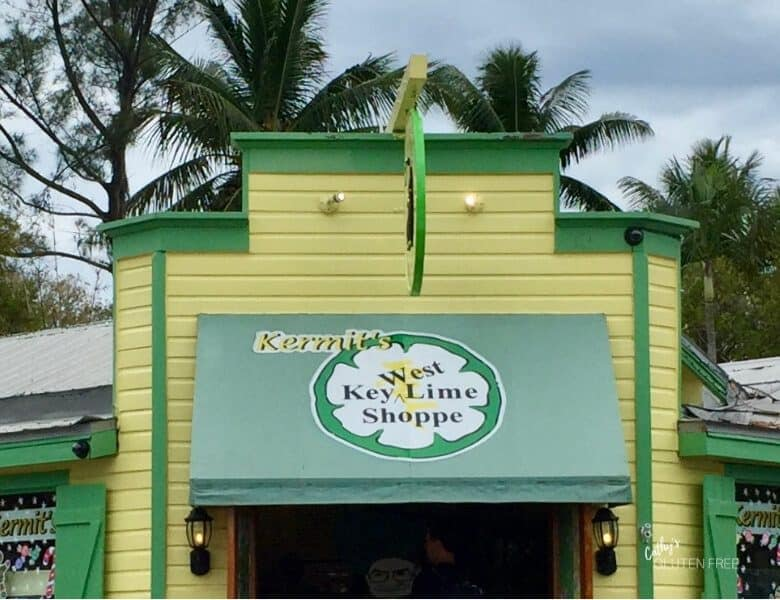 Key Lime Pie Shoppe sign on green awning on yellow building
