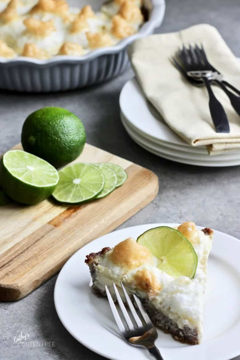 slice of Key lime pie with sliced limes in background