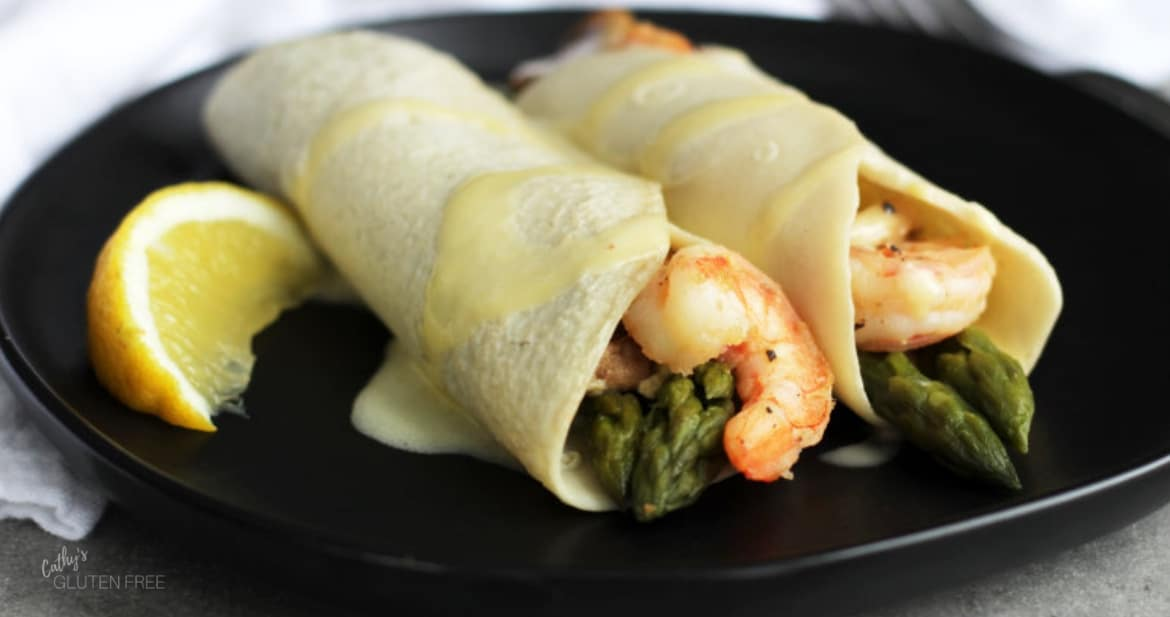 Gluten Free Seafood Crepes with shrimp, asparagus and hollandaise sauce