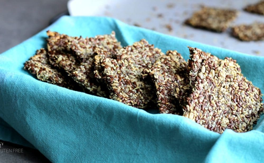 Flax seed crackers in turquoise napkin-lined dish