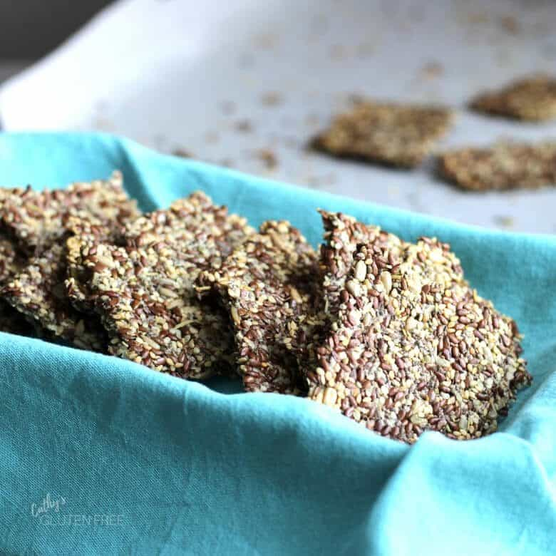 Flax Seed Crackers in a turquoise napkin-lined dish