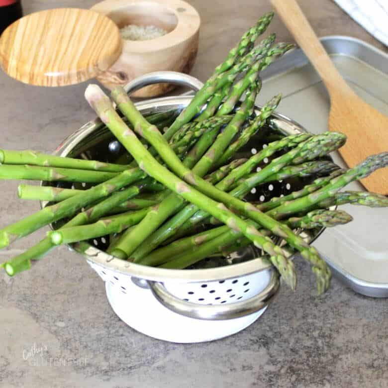 asparagus spears in colander
