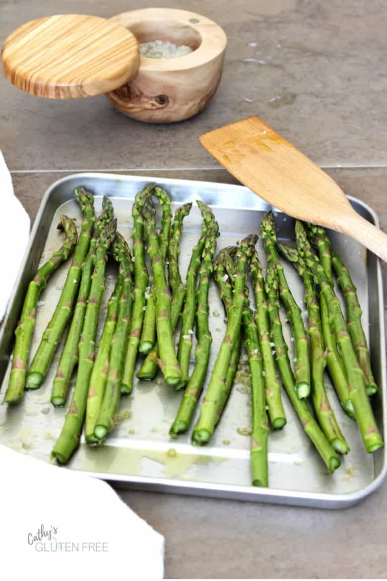 asparagus on pan with salt cellar in background