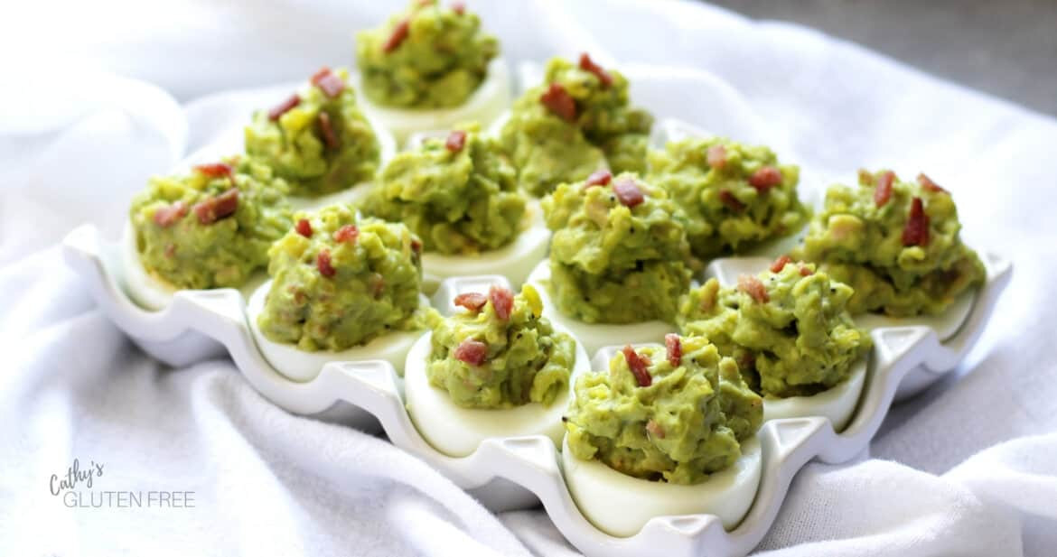 deviled eggs with avocado and bacon