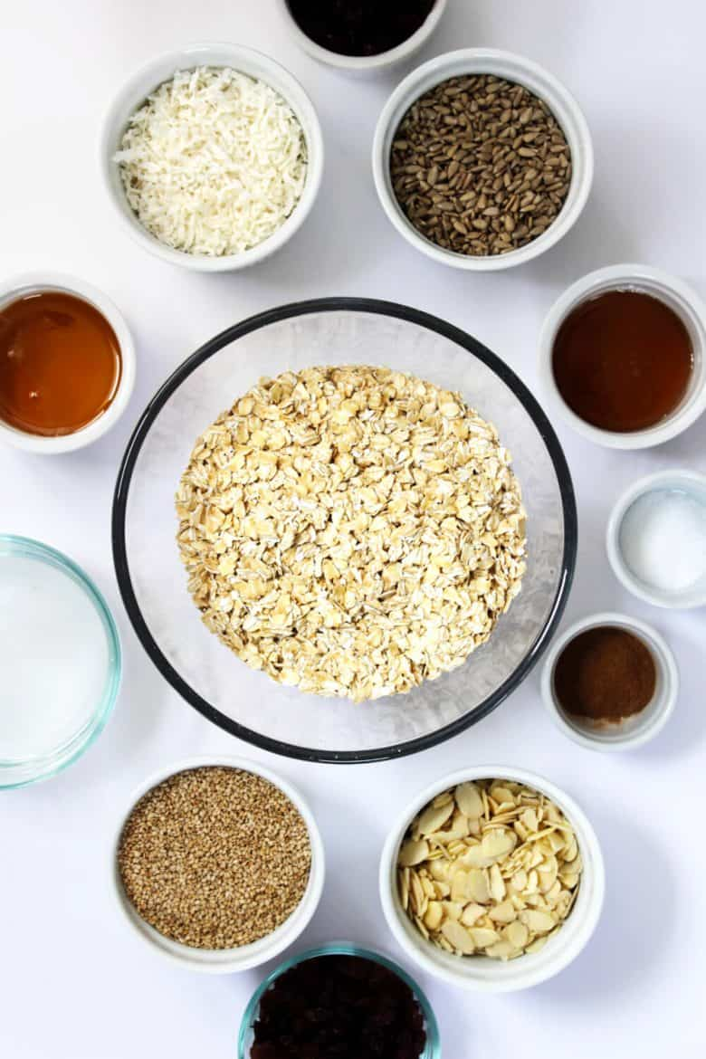 oatmeal, slice almonds, coconut, sesame seeds, sunflower seeds, etc. in bowls
