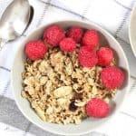 overhead shot of granola with raspberries