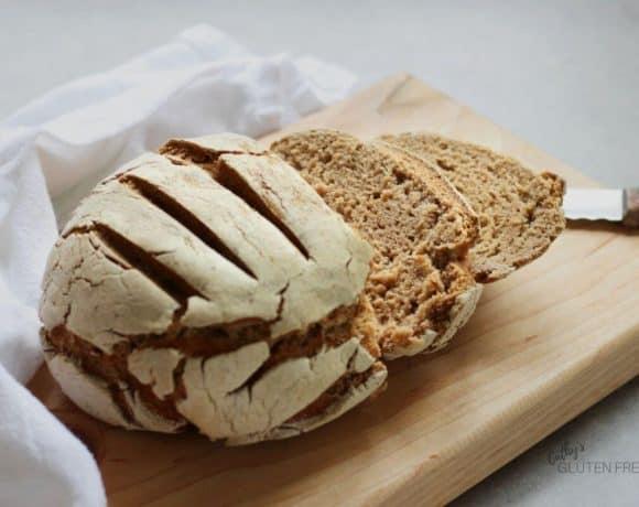 round loaf of bread, half sliced