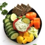 avocado dip surrounded by crudites