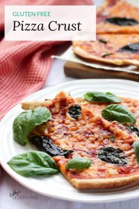 slices of thin gluten free crust pizza garnished with fresh basil leaves