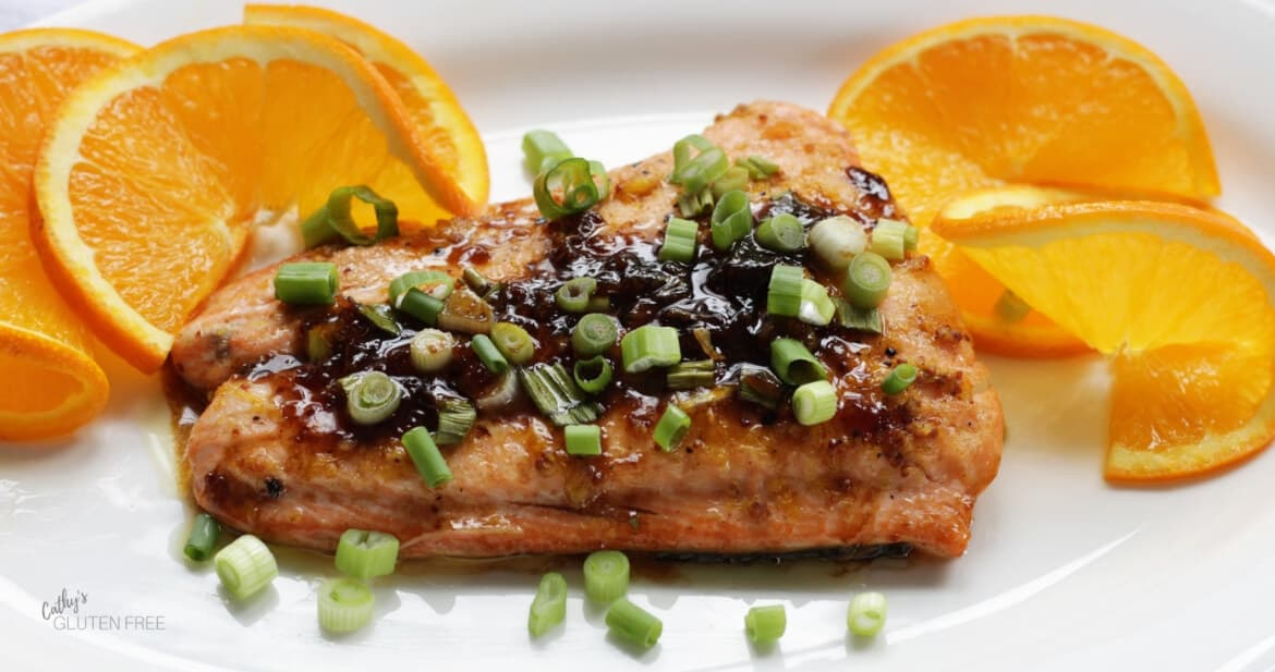 closeup of salmon topped with chopped green onion