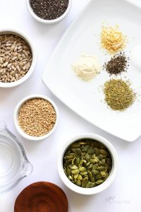 bowls of pepitas, sesame seeds, sunflowere seeds, chia seeds, and seasonings