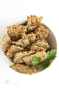 toasted seed crackers in a beige bowl