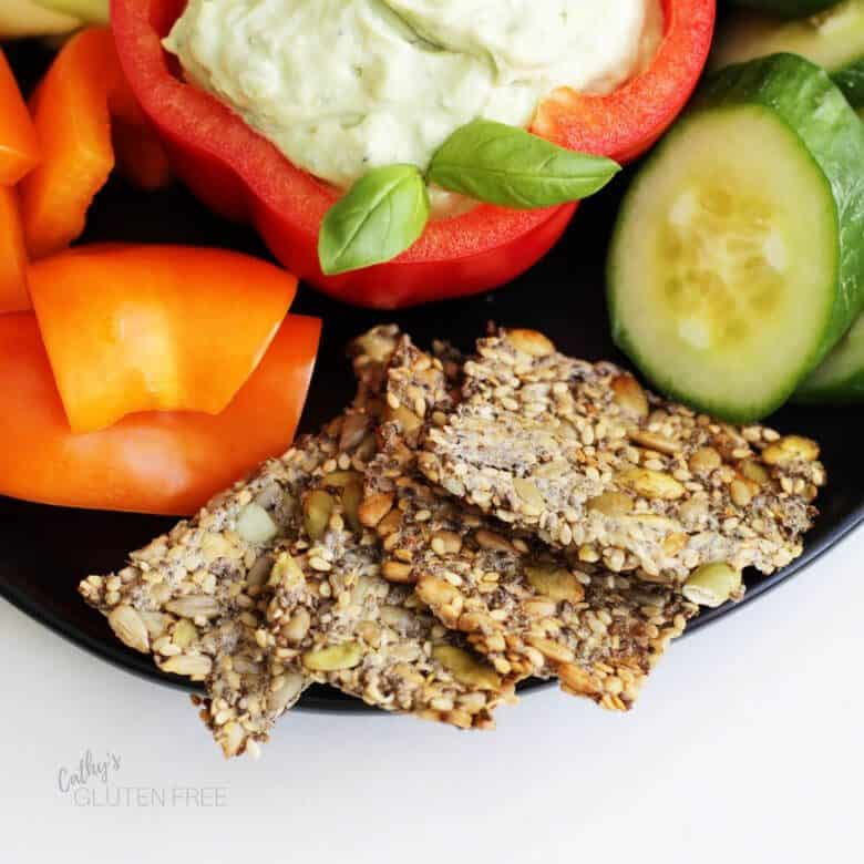 Seed crackers with cucumbers, peppers, and vegan cashew dip