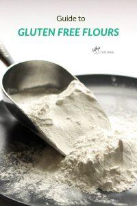 gluten free flour spills from a scoop onto a dark plate