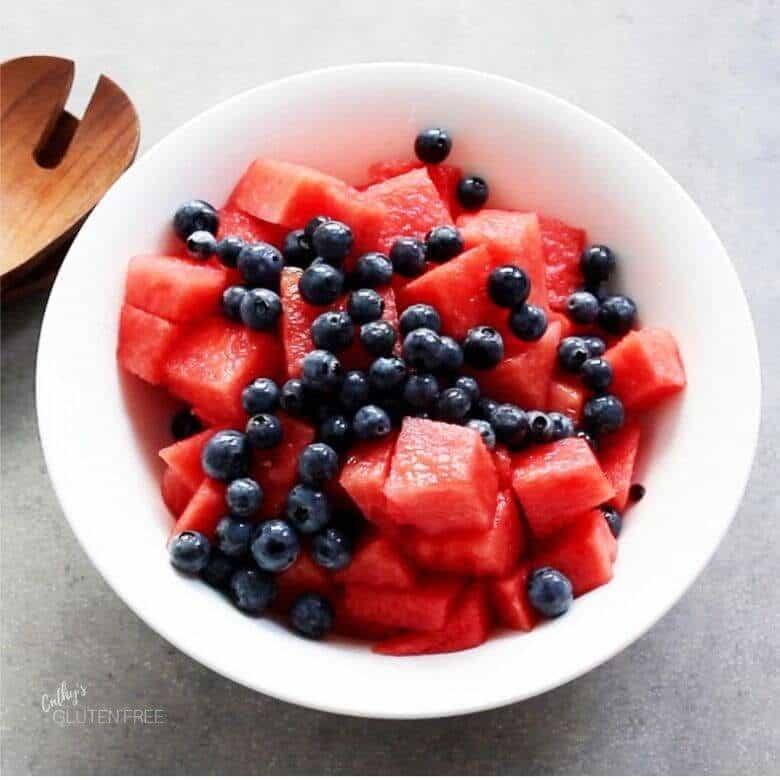 blueberries sprinkled over watermelon chunks
