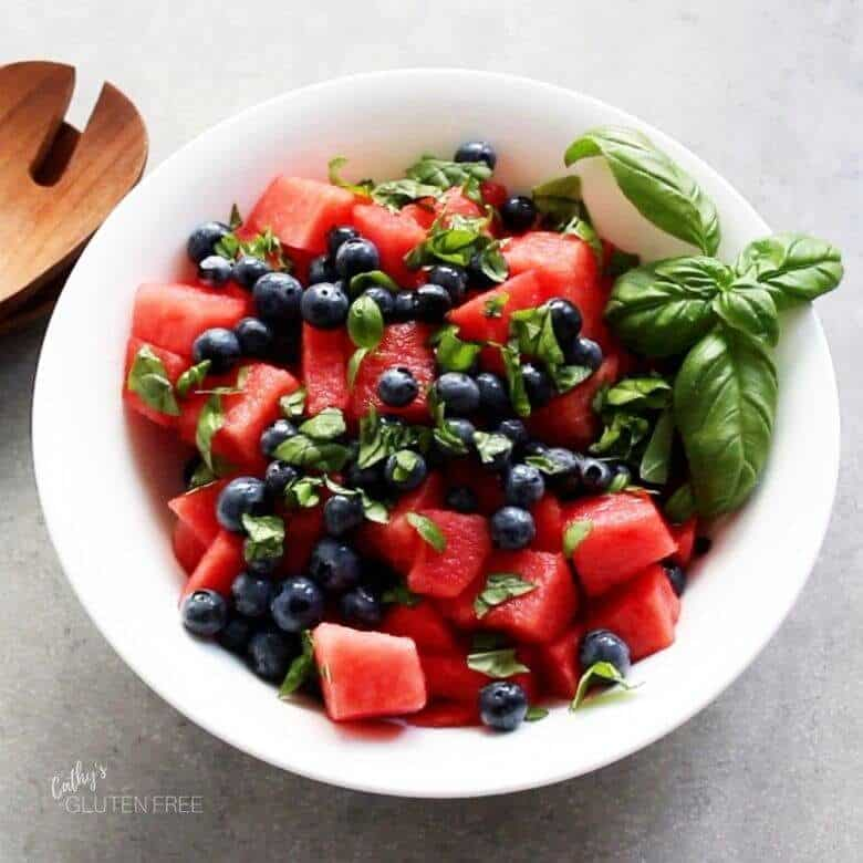 watermelon chunks, fresh blueberries, and chopped basil in a bowl