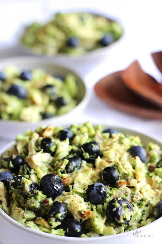 three bowls of broccoli slaw