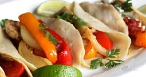 chicken fajitas with red and orange peppers