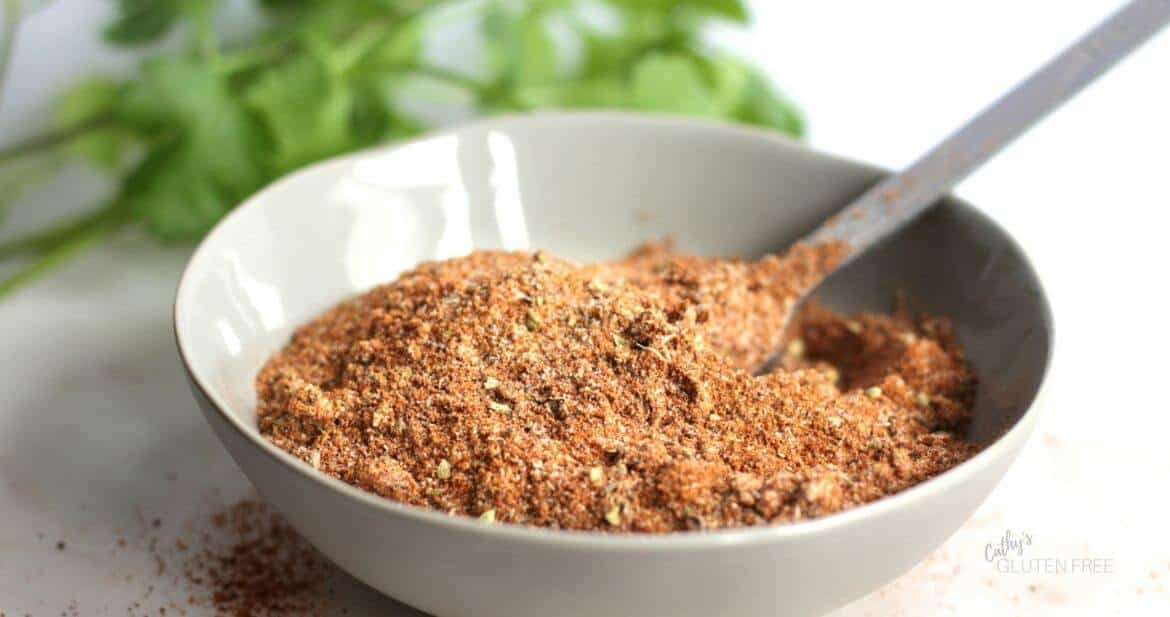 taco seasoning mix and spoon in grey bowl