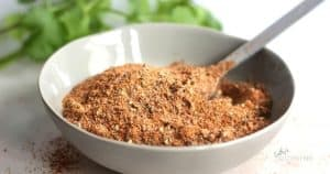 homemade taco seasoning mix with spoon in bowl