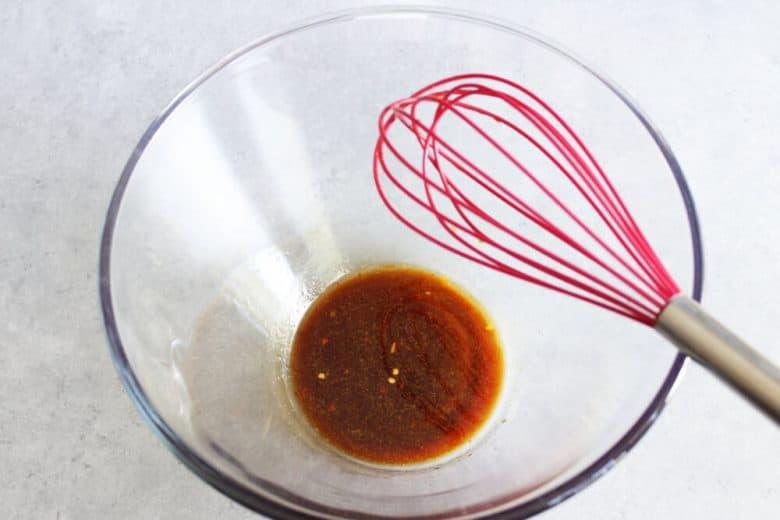 brown vinaigrette in bottom of glass bowl