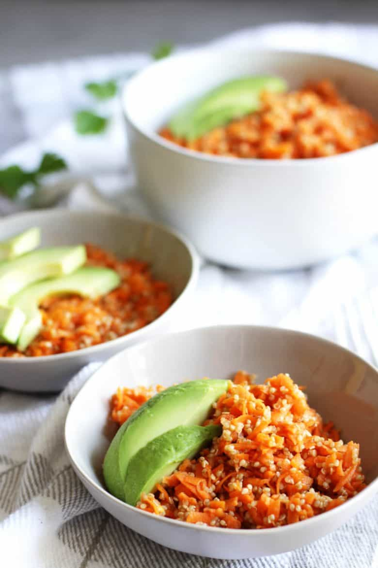 carrot slaw garnished with avocado slices