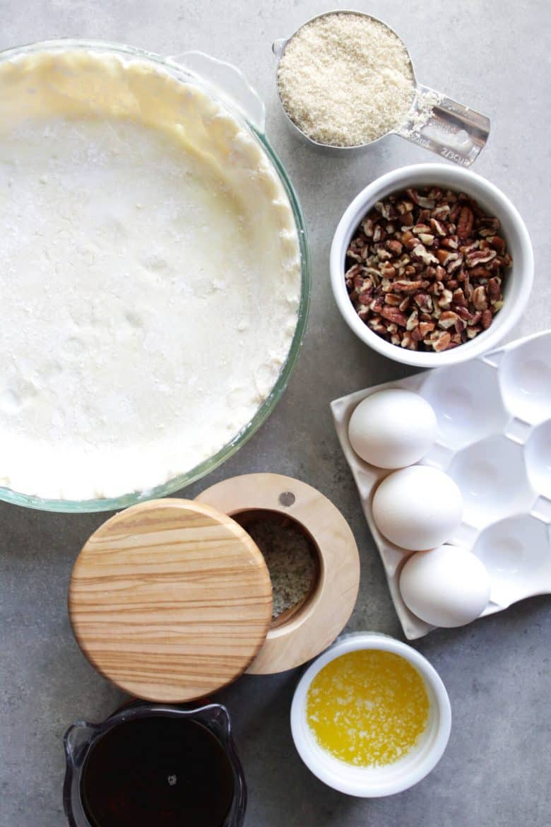 unbaked pie shell, pecans, maple syrup, raw sugar, 3 eggs, salt in cellar, melted butter