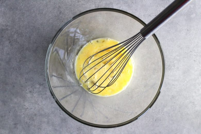 whisked eggs in clear class bowl