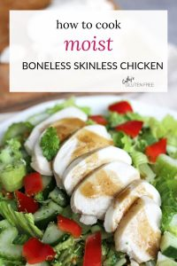 sliced chicken on lettuce with salad dressing drizzled over all
