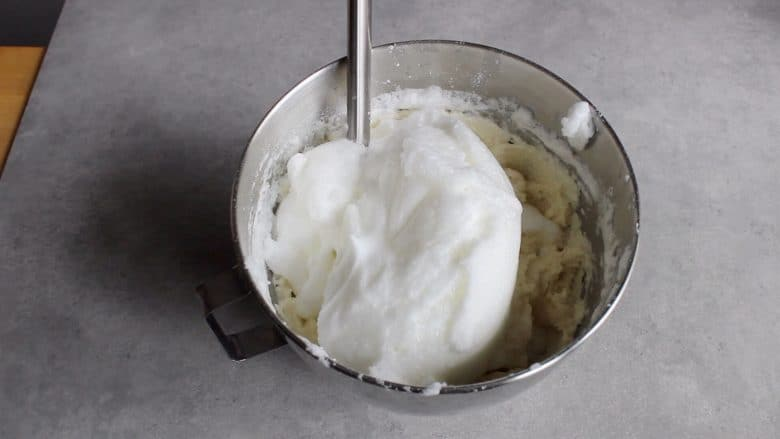 beaten egg whites about to be folded into batter by hand