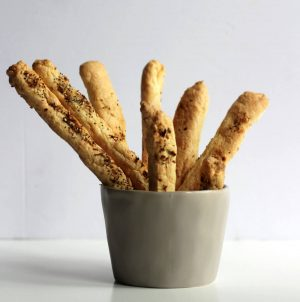 bread sticks standing in a wide mug
